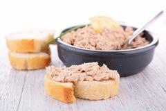 Tuna spread. Bread with tuna spread on wood royalty free stock photo