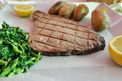 Tuna steak with batatas a murro and broccoli Royalty Free Stock Image