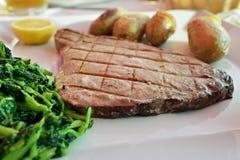 Tuna steak with batatas a murro and broccoli Stock Photos