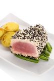 Tuna steak with beans and potatoes. Royalty Free Stock Photography