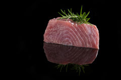 Tuna steak on black. Royalty Free Stock Photos