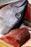 Tuna. A tuna steak and his head in a marketplace Stock Image