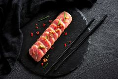 Tuna steak in oil with chilli and rosemary Stock Images