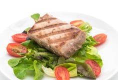 Tuna steak with salad. On white background Royalty Free Stock Photos