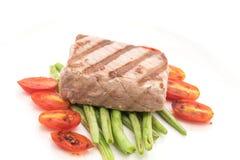 Tuna steak with salad. On white background Royalty Free Stock Photo