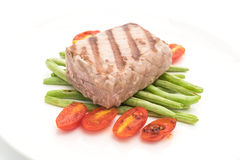 Tuna steak with salad. On white background Stock Photography