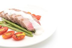 Tuna steak with salad. On white background Stock Photo