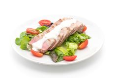 Tuna steak with salad. On white background Royalty Free Stock Images