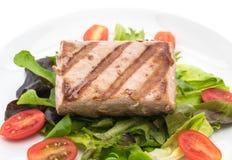 Tuna steak with salad. On white background Stock Image