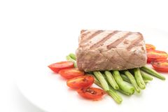 Tuna steak with salad. On white background Royalty Free Stock Photography