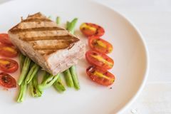 Tuna steak with salad. On wood table Royalty Free Stock Images