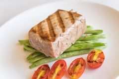 Tuna steak with salad. On wood table Stock Images