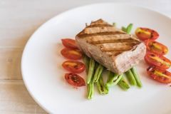 Tuna steak with salad. On wood table Stock Image