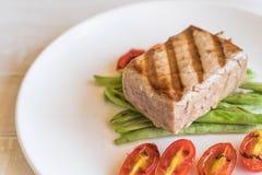 Tuna steak with salad. On wood table Stock Photography