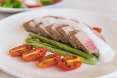 Tuna steak with salad. On wood table Royalty Free Stock Photos