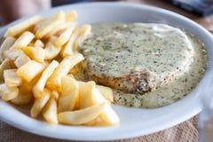 Tuna steak with sauce Royalty Free Stock Photos