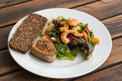 Tuna Steak and vegetable salad v1. Tuna Steak and vegetable salad with shrimps and bread Stock Photos