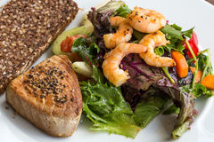 Tuna Steak and vegetable salad v4. Tuna Steak and vegetable salad  with shrimps and bread Royalty Free Stock Photo
