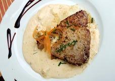 Tuna steak in white sauce Royalty Free Stock Image
