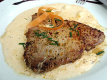 Tuna steak in white sauce Stock Image