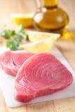 Tuna steaks. Raw tuna steaks on a cutting board Royalty Free Stock Photos