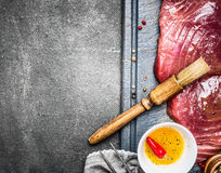 Tuna steaks with oil for grill or cooking on rustic background Stock Images