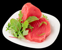 Tuna steaks with salad isolated on black Stock Images