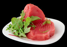 Tuna steaks with salad isolated on black Royalty Free Stock Photos