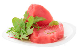 Tuna steaks with salad isolated on white Royalty Free Stock Photo