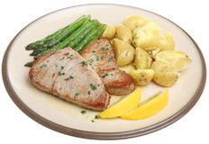 Tuna Steaks with Vegetables. Pan-fried tuna steaks with new potatoes and asparagus Stock Photo