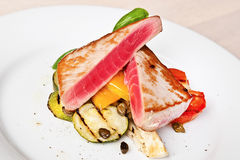 Tuna steaks with vegetables Royalty Free Stock Photo