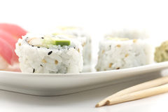 Tuna Sushi California Roll. Authentic Japanese cuisine tuna sushi with california roll, wasabi, and ginger Royalty Free Stock Photos