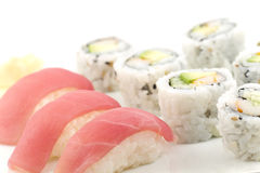 Tuna Sushi California Roll. Authentic Japanese cuisine tuna sushi with california roll, wasabi, and ginger Royalty Free Stock Images