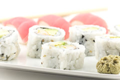 Tuna Sushi California Roll. Authentic Japanese cuisine tuna sushi with california roll, wasabi, and ginger Stock Images