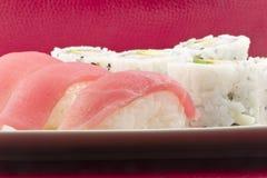Tuna Sushi California Roll. Authentic Japanese cuisine tuna sushi with california roll, wasabi, and ginger Royalty Free Stock Image