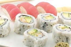 Tuna Sushi California Roll. Authentic Japanese cuisine tuna sushi with california roll, wasabi, and ginger Stock Image