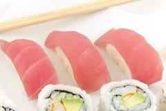 Tuna Sushi California Roll. Authentic Japanese cuisine tuna sushi with california roll, wasabi, and ginger Stock Photos
