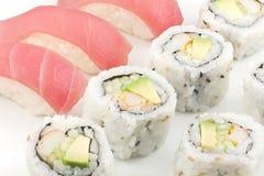 Tuna Sushi California Roll. Authentic Japanese cuisine tuna sushi with california roll, wasabi, and ginger Stock Photo