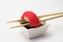 Tuna sushi nigiri. Tuna nigiri in bamboo sticks with soy sauce royalty free stock photo