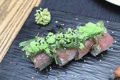 Tuna Sushi rolls on a ceramic plate. Tuna Sushi rolls with seaweeds on a ceramic plate Royalty Free Stock Photos