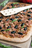 Tuna tart with olives and onions Stock Photos