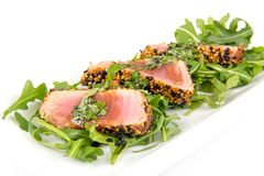 Tuna tataki sesame crust appetizer plate. Over wood backgroung Royalty Free Stock Images
