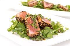 Tuna tataki sesame crust appetizer plate. Over wood backgroung Royalty Free Stock Image