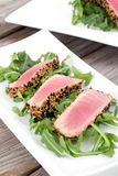 Tuna tataki sesame crust appetizer plate. Over wood backgroung Stock Photos