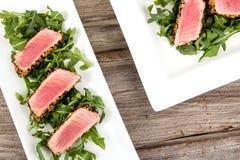 Tuna tataki sesame crust appetizer plate. Over wood backgroung Royalty Free Stock Photos