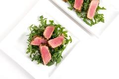 Tuna tataki sesame crust appetizer plate. Over white background Stock Photo