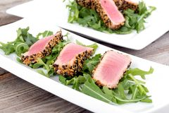 Tuna tataki sesame crust appetizer plate. Over wood backgroung Royalty Free Stock Photography