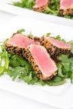 Tuna tataki sesame crust appetizer plate. Over wood backgroung Stock Image