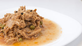 Tuna in tomato sauce and peas Royalty Free Stock Image
