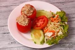 Tuna in tomatoe salad. Tuna salad set on a wood table top Stock Photo